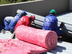 Installing pink aerolite insulation