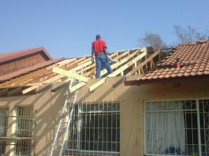 Structural roof repairs. Replacing roof beams and trusses.