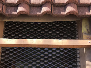 Tile roof secured with Burglar Baffle roof security barrier.